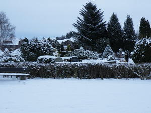 Dorffriedhof im Winter